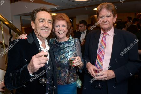 """Stock Image of From left, Robert Lindsay, Cilla Black and Cilla Black and John Madejski pose for photographers at the after party for the opening night of the """"Dirty Rotten Scoundrels"""" musical in the Savoy Hotel in London"""