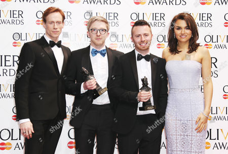 Ed Watson (L) and Samantha Barks (far right) stand next to Finn Ross and Tim Lutkin who won the award for White Light Award for Best Lighting Design for the play Chimerica during the Olivier Awards at the Royal Opera House in central London, . Named after the British actor Laurence Olivier, the awards are given for West End shows and other productions staged in London