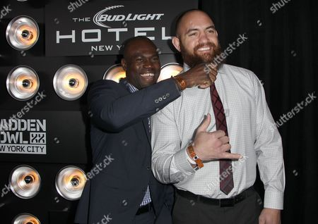 """Uriah Hall and NFL player Travis Brown attends the """"EA SPORTS Madden Bowl XX"""", on in New York"""