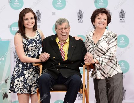 Actor and comedian Jerry Lewis, center, his wife, SanDee Pitnick, right, and his daughter Danielle Lewis pose together as he is honored with a hand and footprint ceremony at TCL Chinese Theatre on in Los Angeles