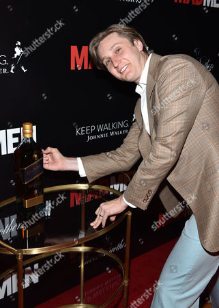 Aaron Staton signs a personalized bottle of Johnnie Walker Blue Label as a cast gift for Matthew Weiner at the Mad Men Cast and Crew Wrap Party presented by Johnnie Walker and Brooks Brothers at The Roosevelt Hotel, in Los Angeles