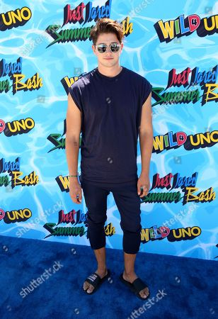 Chris Galya arrive at the Just Jared 4th Annual Summer Bash presented by Uno, in Beverly Hills, Calif