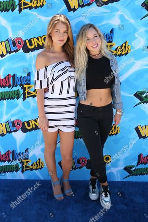 Nathalia Ramos, left, and Skyler Shaye arrive at the Just Jared 4th Annual Summer Bash presented by Uno, in Beverly Hills, Calif