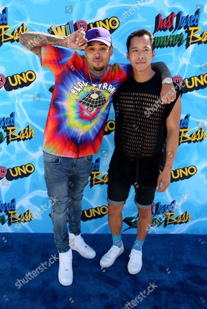 Chris Brown, left, and Jared Eng arrive at the Just Jared 4th Annual Summer Bash presented by Uno, in Beverly Hills, Calif