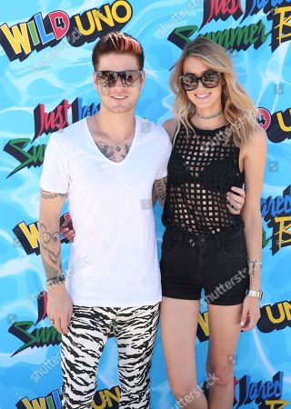 Nash Overstreet and guest arrive at the Just Jared 4th Annual Summer Bash presented by Uno, in Beverly Hills, Calif