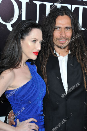 Stock Image of Evis Xheneti, at left, and James Shaffer seen at the LA premiere of The Quiet Ones at Ace Hotel, in Los Angeles, CA