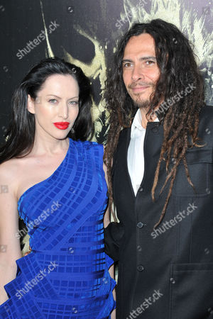 Evis Xheneti, at left, and James Shaffer seen at the LA premiere of The Quiet Ones at Ace Hotel, in Los Angeles, CA
