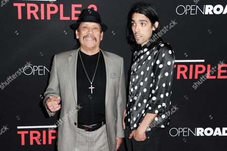 """Danny Trejo and son Gilbert Trejo arrive at the LA Premiere of """"Triple 9"""" held at the Regal Theater LA Live on Tuesday, Feb.16, 2016, in Los Angeles"""