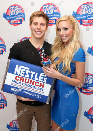 Actor Thomas Kasp, left, and Casey Reinhardt, owner of Casey's Cupcakes, participate in the kick-off of the Nestle Crunch 75th Birthday Showdown at Sweet E's on in Los Angeles. Fans can vote at Facebook.com/NestleCrunch for their favorite treat or bakery in the Nestle Crunch 75th Birthday Showdown