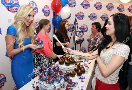 Casey Reinhardt, owner of Casey's Cupcakes, left, is interviewed during the kick-off of the Nestle Crunch 75th Birthday Showdown at Sweet E's on in Los Angeles. Fans can vote at Facebook.com/NestleCrunch for their favorite treat or bakery in the Nestle Crunch 75th Birthday Showdown