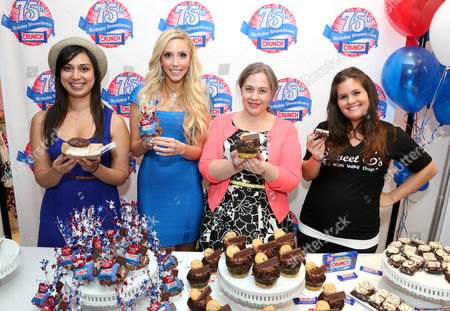 From left, Nastassia Johnson, director of operations, Coolhaus, Casey Reinhardt, owner of Casey's Cupcakes, Lisa Hess-Marks, head baker at Crumbs bakery and Erica Tucker, owner of Sweet E's participate in the kick-off of the Nestle Crunch 75th Birthday Showdown at Sweet E's on in Los Angeles. Fans can vote at Facebook.com/NestleCrunch for their favorite treat or bakery in the Nestle Crunch 75th Birthday Showdown