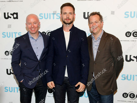 """USA Network president Chris McCumber, from left, Patrick J. Adams and David Costabile arrive at """"Behind The Lens: An Intimate Look At The World Of Suits"""" at the Meatpacking District Gallery, in New York"""