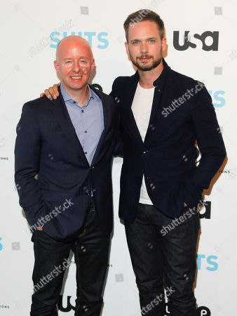 """USA Network president Chris McCumber, left, and Patrick J. Adams, right, arrive at """"Behind The Lens: An Intimate Look At The World Of Suits"""" at the Meatpacking District Gallery, in New York"""
