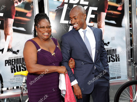 "Actor Wole Parks and his mother Lilith attend the world premiere of ""Premium Rush"" at the Regal Union Square Theaters on in New York"