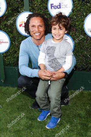 Cobi Jones, left, and son Cayden Jones attends Safe Kids Day LA Event at The Lot on in West Hollywood, Calif