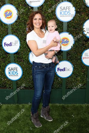 Rebecca Budig, left, and daughter Charlotte Jo Benson attends Safe Kids Day LA Event at The Lot on in West Hollywood, Calif