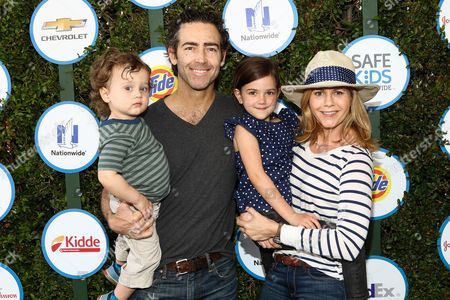 John Fortson, left, Christie Lynn Smith and children attends Safe Kids Day LA Event at The Lot on in West Hollywood, Calif