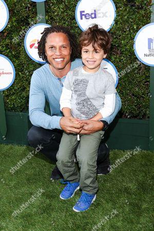Cobi Jones, left, and son Cayden Jones attend Safe Kids Day LA Event at The Lot on in West Hollywood, Calif