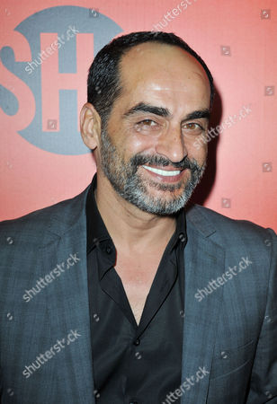 Stock Picture of David Negahban arrives at the Showtime Primetime Emmy's Eve Party at the Sunset Tower on in Los Angeles