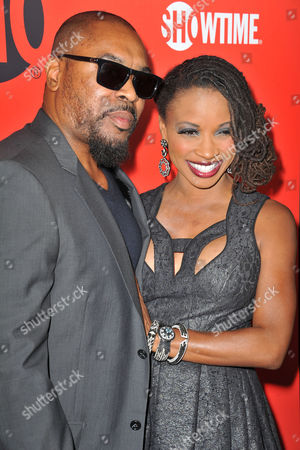 Shanola Hampton, at right, and her husband, Daren Dukes arrives at the Showtime Primetime Emmy's Eve Party at the Sunset Tower on in Los Angeles