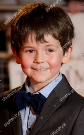 Oaklee Pendergast who plays Simon Belon arrives for the UK Premiere of The Impossible at the BFI Imax in central London