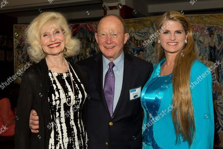 Betty Moran, Rudy Moran and Bonnie Comley pose together at UMass Lowell Celebration of Sardi's Caricature of Stewart F. Lane & Bonnie Comley at Sardi's on