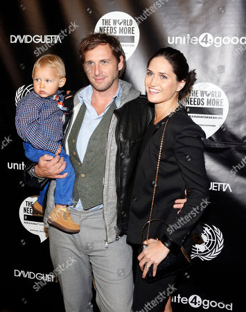 """Actor Josh Lucas, his wife Jessica Henriquez and son Noah attend a party celebrating the projection of musician David Guetta's """"One Voice"""" music video on the side of U.N. headquarters in support of """"The World Needs More____"""" campaign, sponsored by unite4:good, at U.N. headquarters"""