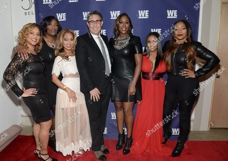 "Stock Picture of Cast members from ""SWV Reunited"" and ""Love Thy Sister"", from left, Ruby Rucker, Taj Johnson George, Ione Rucker, WE tv President Marc Juris, Cheryl Clemons, Ellen Rucker Carter and Leanne Lyons attend the WE tv Holiday Showcase at 54 Below on in New York"