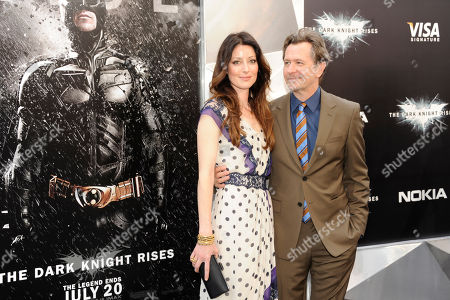 """Actor Gary Oldman and wife, Alexandra Edenborough, arrive to the world premiere of """"The Dark Knight Rises"""", in New York"""