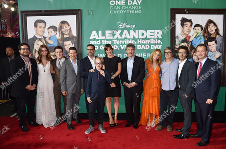 """Composer Christophe Beck, and from left, Kerris Dorsey, Dylan Minnette, producer Dan Levine, Steve Carell, Ed Oxenbould, Jennifer Garner, Alan Horn, chairman of the Walt Disney Studios, Bella Thorne, director Miguel Arteta, producer Shawn Levy and Sean Bailey, president of Walt Disney Studios Motion Picture Production, arrive at the world premiere of """"Alexander And The Terrible, Horrible, No Good, Very Bad Day"""" at the El Capitan Theatre, in Los Angeles"""