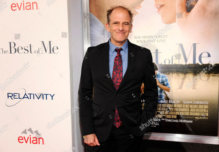 """Michael Hoffman, director of """"The Best of Me,"""" poses at the premiere of the film at Regal Cinemas L.A. Live, in Los Angeles"""