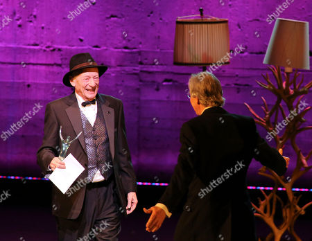 """From left, Alan Mandell, Lead Actor in a Play for his role as Estragon in """"Waiting for Godot"""" is about to get hugged by """"Godot"""" co-star Barry McGovern during the 2012 LA Stage Alliance Ovation Awards ceremony held at the Los Angeles Theatre, in Los Angeles, Calif"""