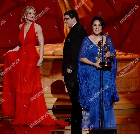 """SEPTEMBER 15: (L-R) Presenters Jennifer Morrison (L) and Adam Horowitz (C) present the Outstanding Costumes For A Variety Program Or A Special award to Maria Rosario Mendoza (R) for """"Opening Ceremony Of The XVI Pan American Games Guadalajara 2011"""" at the Academy of Television Arts & Sciences 64th Primetime Creative Arts Emmy Awards at Nokia Theatre L.A. Live on in Los Angeles, California"""