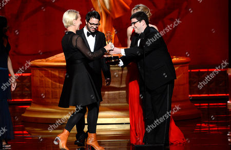 """LOS ANGELES, CA - SEPTEMBER 15: Presenters Eddy Kitsis (2nd L), Jennifer Morrison (3rd L), and Adam Horowitz (R) present the Outstanding Costumes For A Series award to Michele Clapton (L) for """"Game Of Thrones - The Prince Of Winterfell"""" at the Academy of Television Arts & Sciences 64th Primetime Creative Arts Emmy Awards at Nokia Theatre L.A. Live on in Los Angeles, California"""
