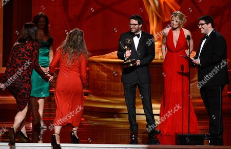 """SEPTEMBER 15: Presenters Eddy Kitsis (3rd R), Jennifer Morrison (2nd R), and Adam Horowitz (R) present the Outstanding Costumes For A Miniseries, Movie Or A Special award to Yvonne Duckett (L) and Annie Symons (2nd L) for the """"Great Expectations (Masterpiece)"""" at the Academy of Television Arts & Sciences 64th Primetime Creative Arts Emmy Awards at Nokia Theatre L.A. Live on in Los Angeles, California"""