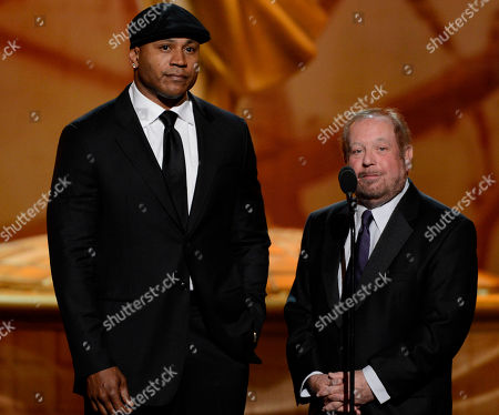 SEPTEMBER 15: Presenters LL Cool J (L) and Ken Ehrlich onstage at the Academy of Television Arts & Sciences 64th Primetime Creative Arts Emmy Awards at Nokia Theatre L.A. Live on in Los Angeles, California