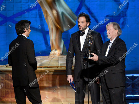 LOS ANGELES, CA - SEPTEMBER 15: Silas Weir Mitchell and Jim Kouf present the award for Outstanding Special Visual Effects to the Team from Game of Thrones - Valar Morghulis onstage at the Academy of Television Arts & Sciences 64th Primetime Creative Arts Emmy Awards at Nokia Theatre L.A. Live on in Los Angeles, California