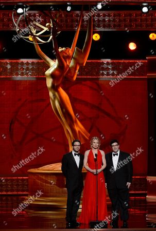 SEPTEMBER 15: (L-R) Presenters Eddy Kitsis, Jennifer Morrison, and Adam Horowitz present the Outstanding Costumes For A Variety Program Or A Special award at the Academy of Television Arts & Sciences 64th Primetime Creative Arts Emmy Awards at Nokia Theatre L.A. Live on in Los Angeles, California