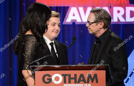 Actor James Gandolfini's widow Deborah Lin and son Michael Gandolfini, center, thank actor Steve Buscemi for his tribute to the late actor at the 23rd Annual Gotham Independent Film Awards at Cipriani's Wall Street on in New York