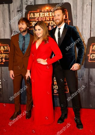 Country Group Lady Antebellum, from left. Dave Haywood, Hilary Scott and Charles Kelley, pose at the 2014 American Country Countdown Awards Red Carpet at the Music City Center on in Nashville, Tenn