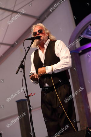 Johnny Sansone performs at the 2014 New Orleans Jazz & Heritage Festival at Fair Grounds Race Course, in New Orleans