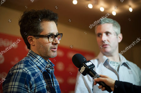 """Stock Photo of Directors Jonathan Milott and Cary Murnion speak during an interview at the world premiere of the film """"Cooties"""" during the 2014 Sundance Film Festival, on in Park City, Utah"""