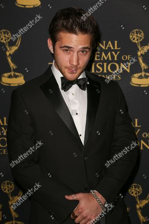 Casey Moss arrives at the 2015 Daytime Creative Arts Emmy Awards at The Universal Hilton, in Universal City, Calif