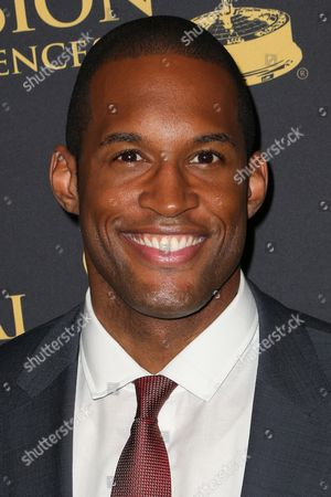 Lawrence Saint-Victor arrives at the 2015 Daytime Creative Arts Emmy Awards at The Universal Hilton, in Universal City, Calif
