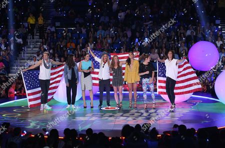 Abby Wambach, and from left, Carli Lloyd, Ali Krieger, Ashlyn Harris, Christie Rampone, Christen Press, Kelley O'Hara, and Hope Solo of the U.S. women's national soccer team speak at the 2015 Kids' Choice Sports Awards show at Pauley Pavilion, in Los Angeles