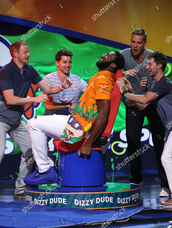 Andre Drummond plays a game on stage at the 2015 Kids' Choice Sports Awards show at Pauley Pavilion on in Los Angeles