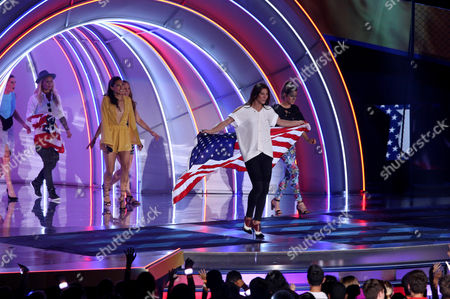 Ali Krieger, and from left, Ashlyn Harris, Christen Press, Christie Rampone, Hope Solo and Kelley O'Hara speak during the 2015 Kids' Choice Sports Awards show at Pauley Pavilion on in Los Angeles