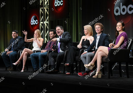 """Creator/Executive Producer Adam Goldberg, from left, AJ Michalka, Troy Gentile, Jeff Garlin, Wendi McLendon-Covey, Sean Giambrone and Hayley Orrantia participate in """"The Goldbergs"""" panel at the Disney/ABC Summer TCA Tour at the Beverly Hilton Hotel, in Beverly Hills, Calif"""