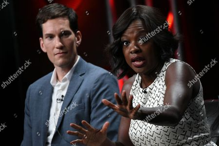 """Stock Image of Creator/Executive Producer Peter Nowalk, left, and actress Viola Davis speak onstage during the """"Greyâ?™s Anatomy,â?? â?oeScandal,â?? and â?oeHow to Get Away with Murder"""" panel at the Disney/ABC Summer TCA Tour held at the Beverly Hilton Hotel, in Beverly Hills, Calif"""