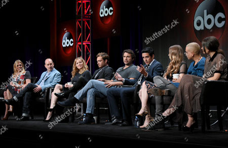 """Executive producer Amy B. Harris, from left, creator/executive producer Steven Baigelman, Erika Christensen, Ed Westwick, Jeremy Sisto, Gabriel Luna, Taissa Farmiga, Evan Ross and Karolina Wydra participate in the """"Wicked City"""" panel at the Disney/ABC Summer TCA Tour at the Beverly Hilton Hotel, in Beverly Hills, Calif"""